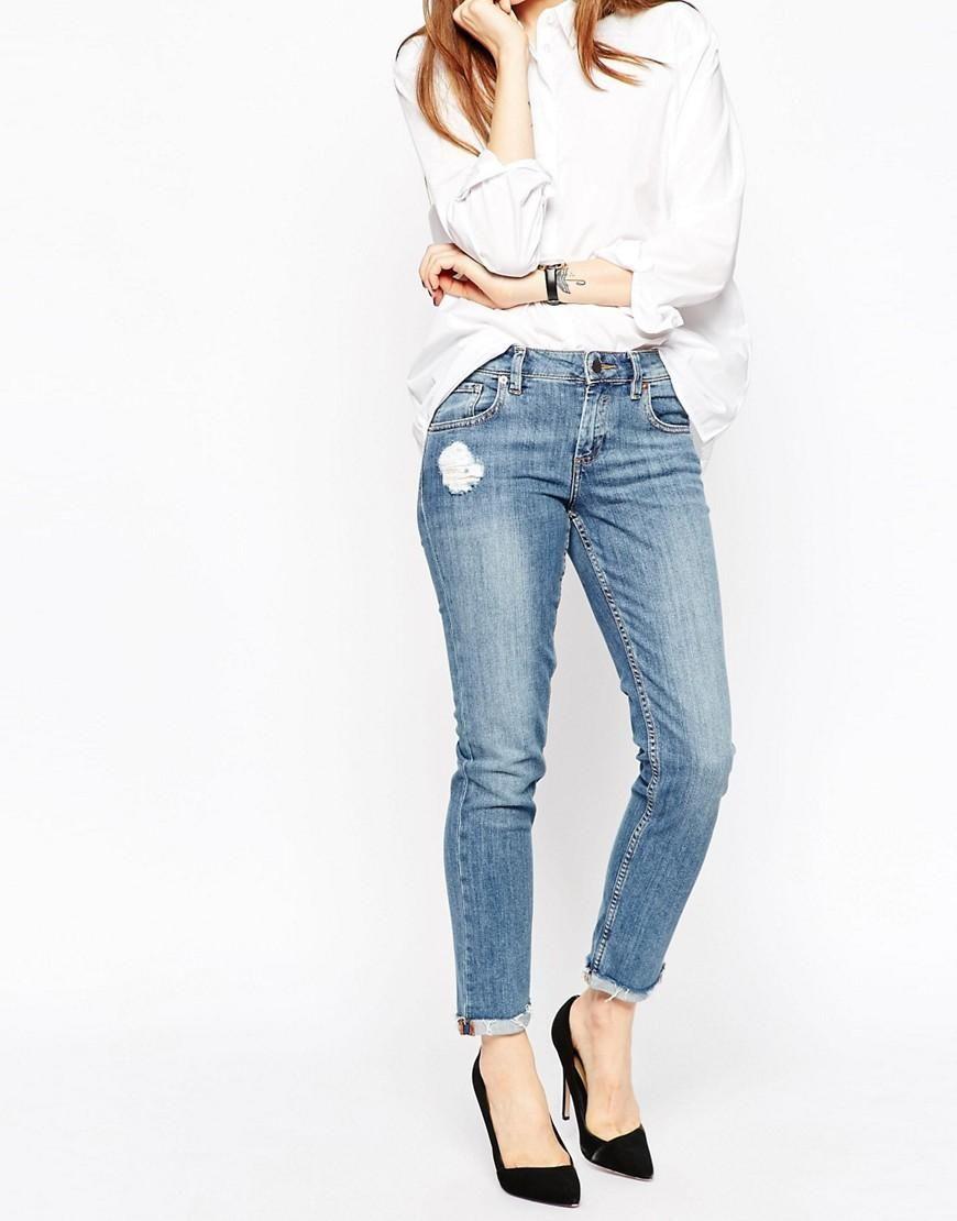 ASOS | ASOS Kimmi Shrunken Boyfriend Jeans in Lily Mid Wash with Rip and Repair at ASOS