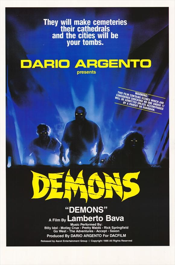 DEMONS directed by Lamberto Bava  Lobby Card.    In 1985, Dario Argento and Lamberto Bava put together what is probably the greatest of all Heavy Metal horror films, Demons.Written by Argento and directed by Bava, the film is a blast of gooey fun that encompasses all that was great about '80s horror.