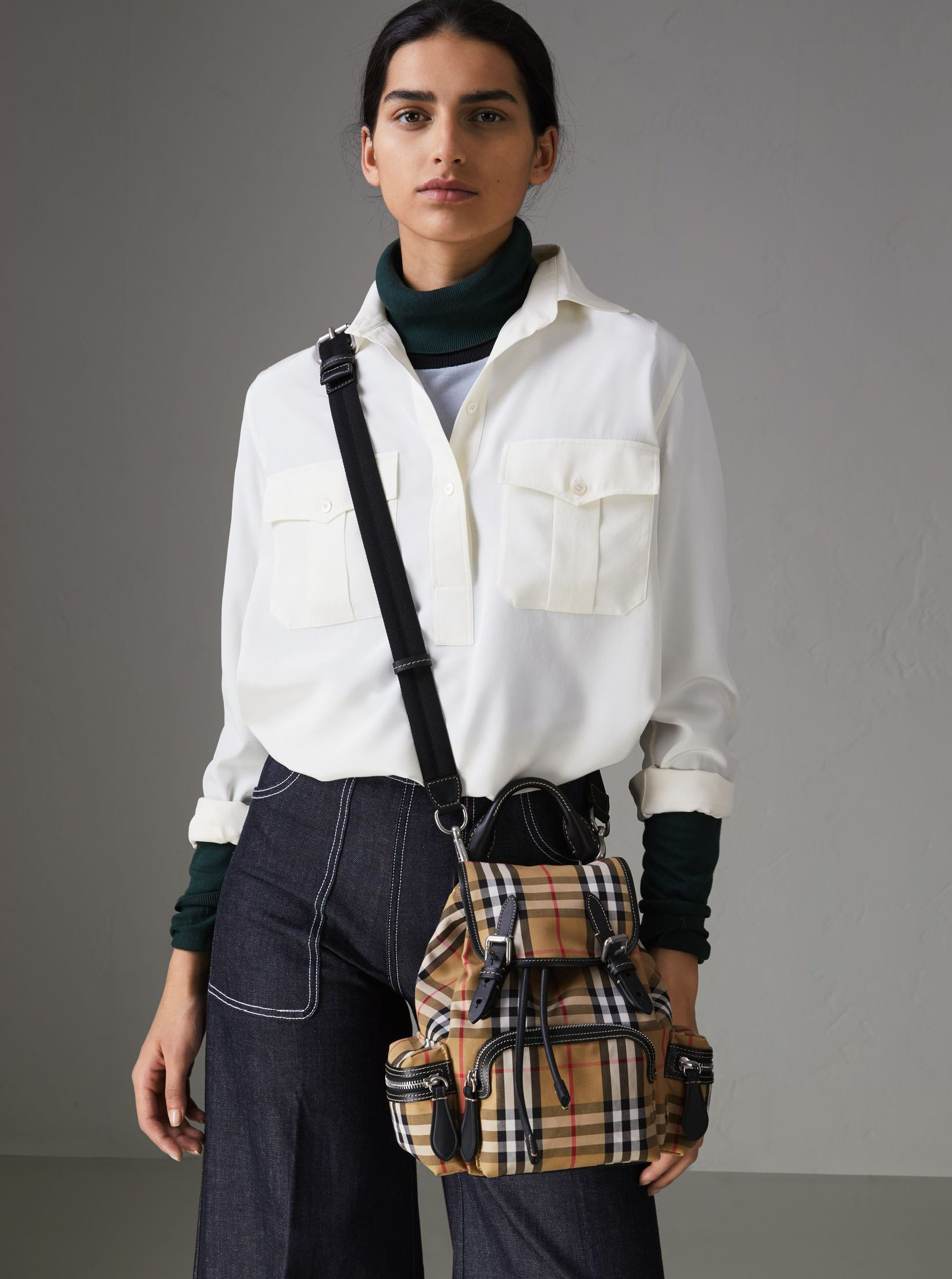... our timeless  Burberry backpack is updated in Vintage check cotton and  leather trims with an additional strap for crossbody carrying. 5c6edf3034a1e