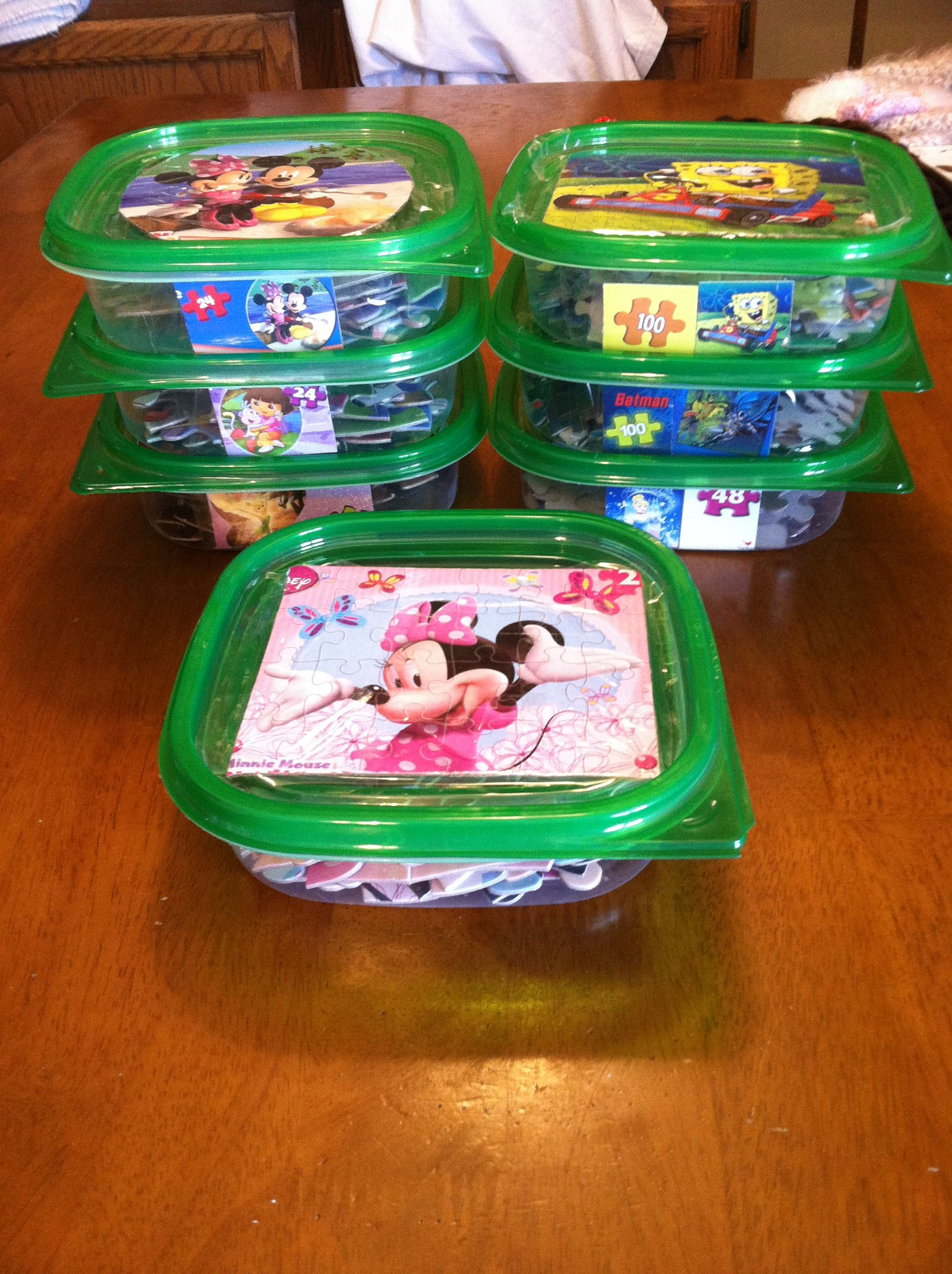 Use dollar store containers to keep kids puzzles organized. Tape ...