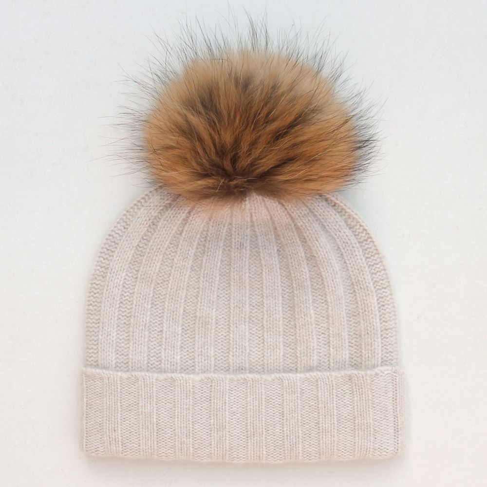 Luxurious and warm this fluffy pom pom cashmere bobble hat is perfect for  the autumn and winter months. Made from 100% cashmere the natural fur pom  pom ... 0de4d65b0c8