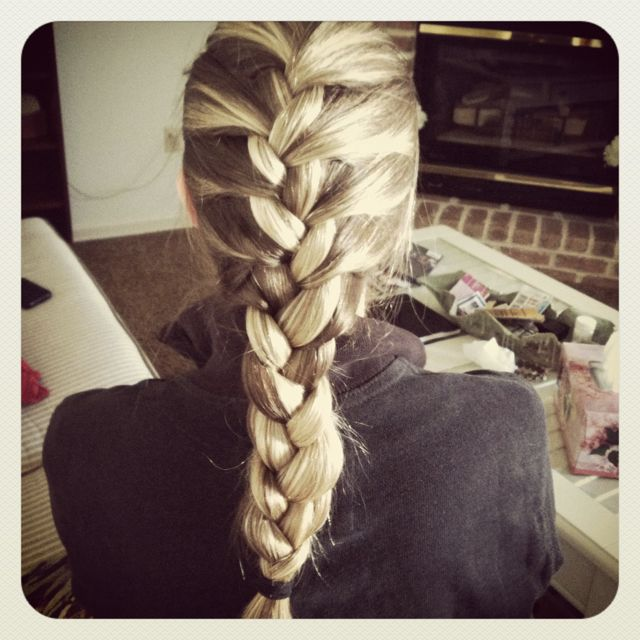 French braid in blonde highlighted hair