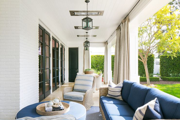 Beautiful White And Blue Covered Outdoor Patio Features Beadboard Clad  Ceiling Studded With Iron Lanterns Alongside