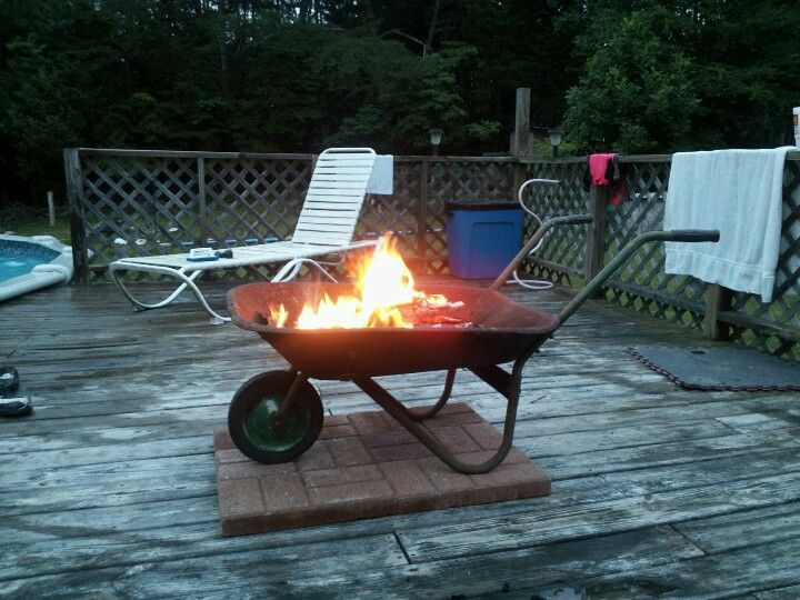Easy Portable Fire Pit Take A Yard Sale Wheel Barrow We Paid 5 And Line With Some Sheet Metal You Don T Wa Cool Fire Pits Outside Fire Pits Backyard Fire