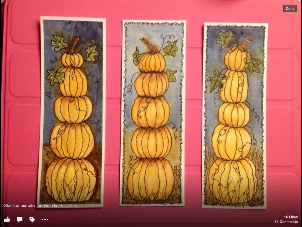 Stacked pumpkin bookmarks done in watercolor.