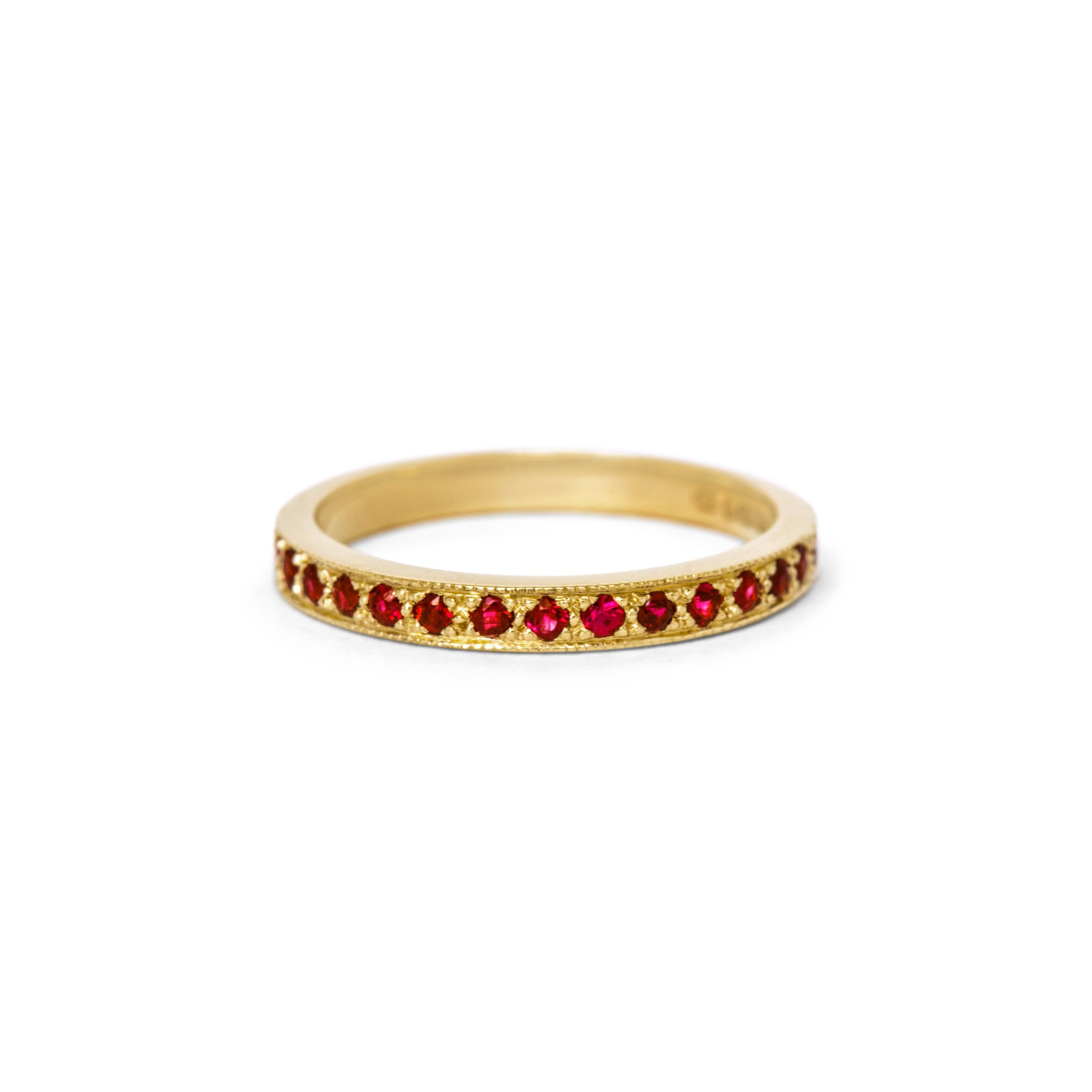 A ruby wedding anniversary gift - a delicate grain set ruby half eternity ring in 18 carat yellow gold.