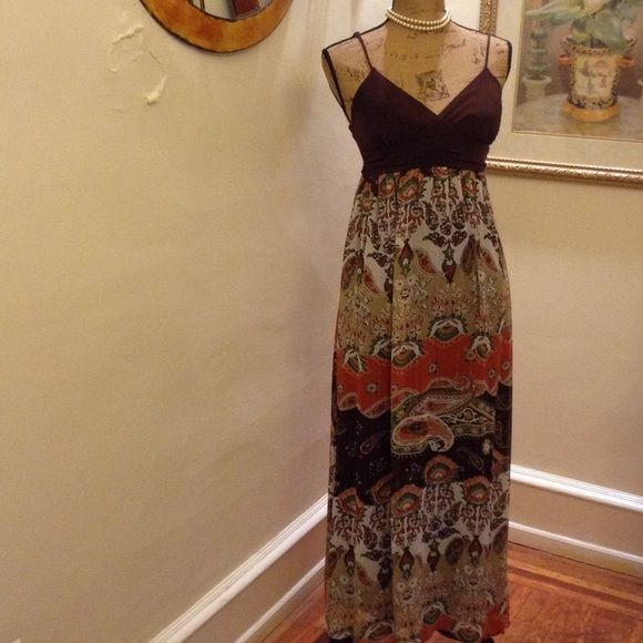 """The Maxi Beauty ❤️❤️ ON SALE❤️❤️ This maxi. Dress is bursting with paisley and beautiful flowers in array of colors. With a gathered high wrist, v neck cross over bark brown bra padded (34"""") top and spaghetti adjustable straps. Candie's Dresses Maxi"""