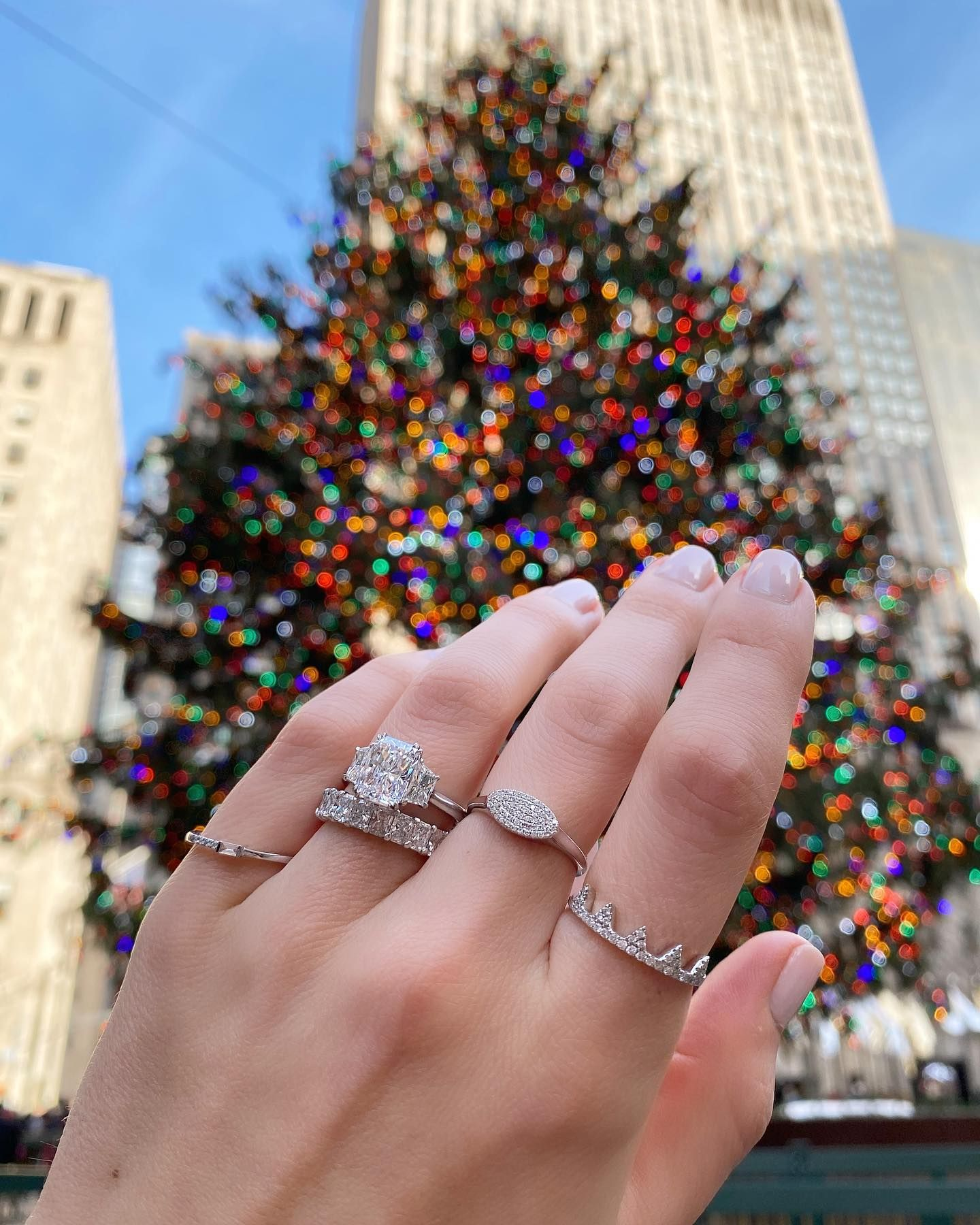Oh what a beautiful sight 😍🎄💍 There's nothing like Rockefeller center during this time of year! Tap for the bling 💎 & comment your favorite places in NYC to get into the holiday spirit! ⬇️🎁 - Radiant cut engagement ring style # SOR-17470 - #laurenbjewelry #radiantcut #rockefellerchristmastree #christmasinnyc #threestonering