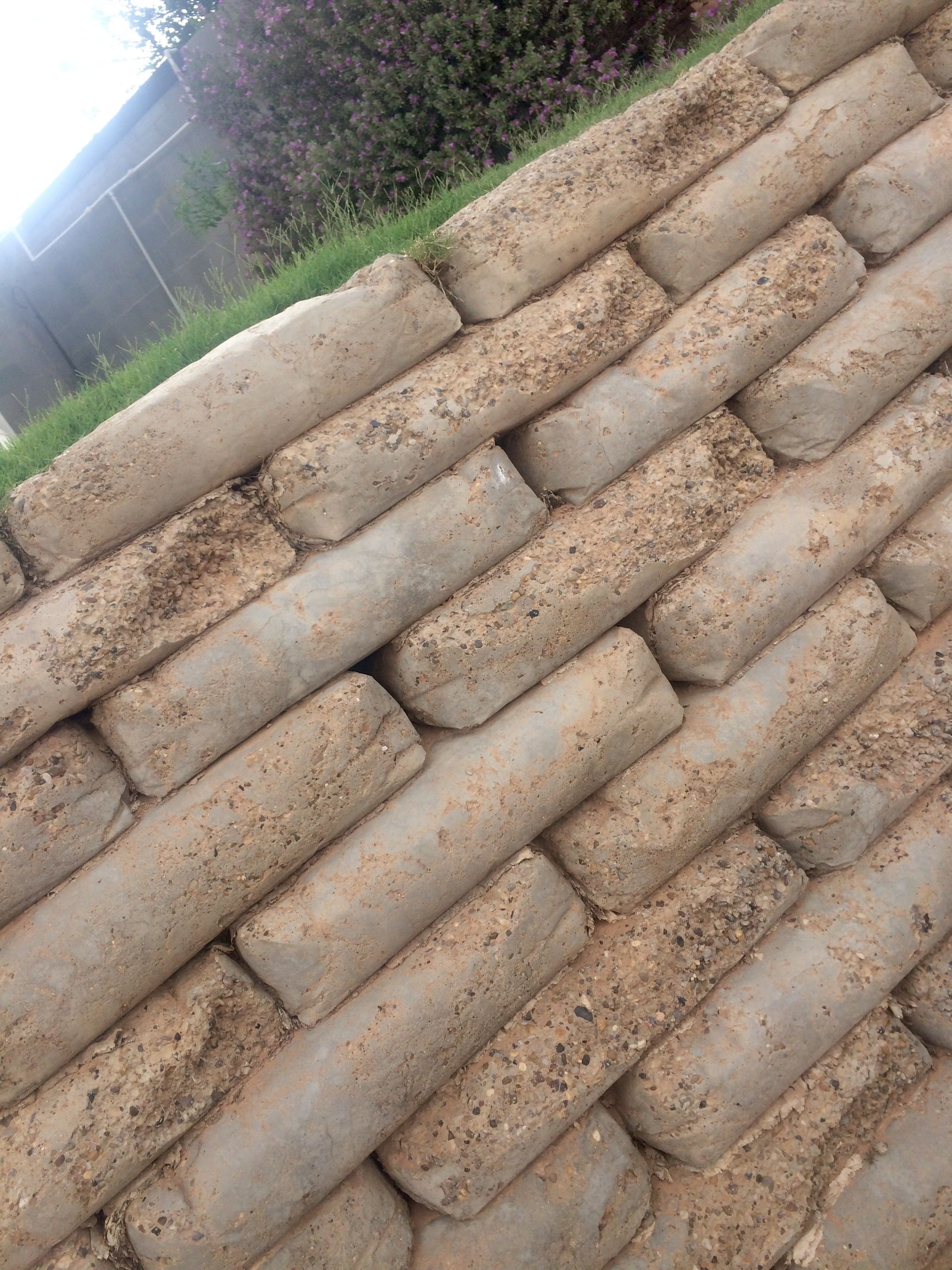 Retaining Wall Made Out Of Concrete Bags Landscaping