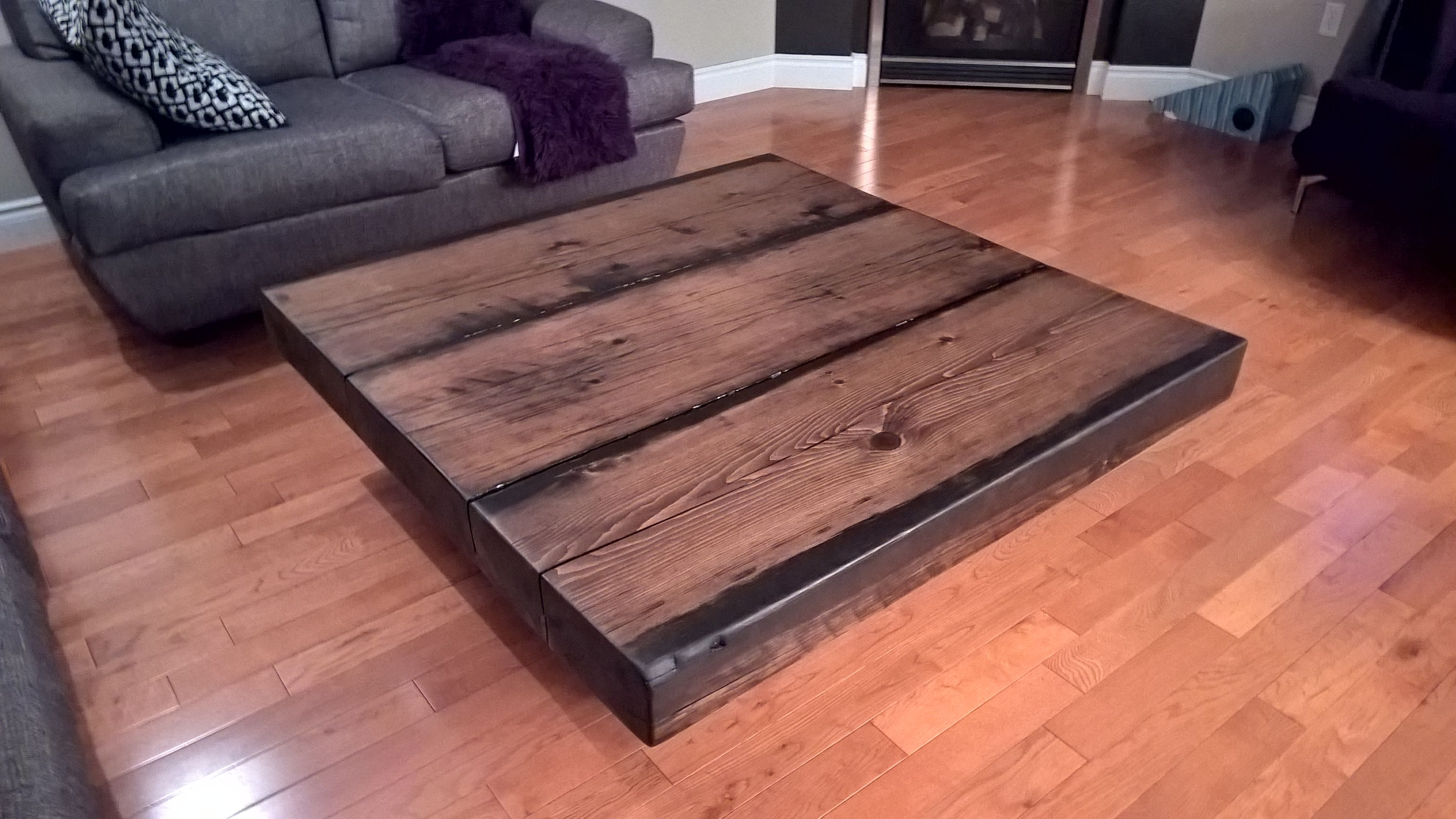 A Massive Coffee Table Made From Reclaimed Spruce Barn Beams