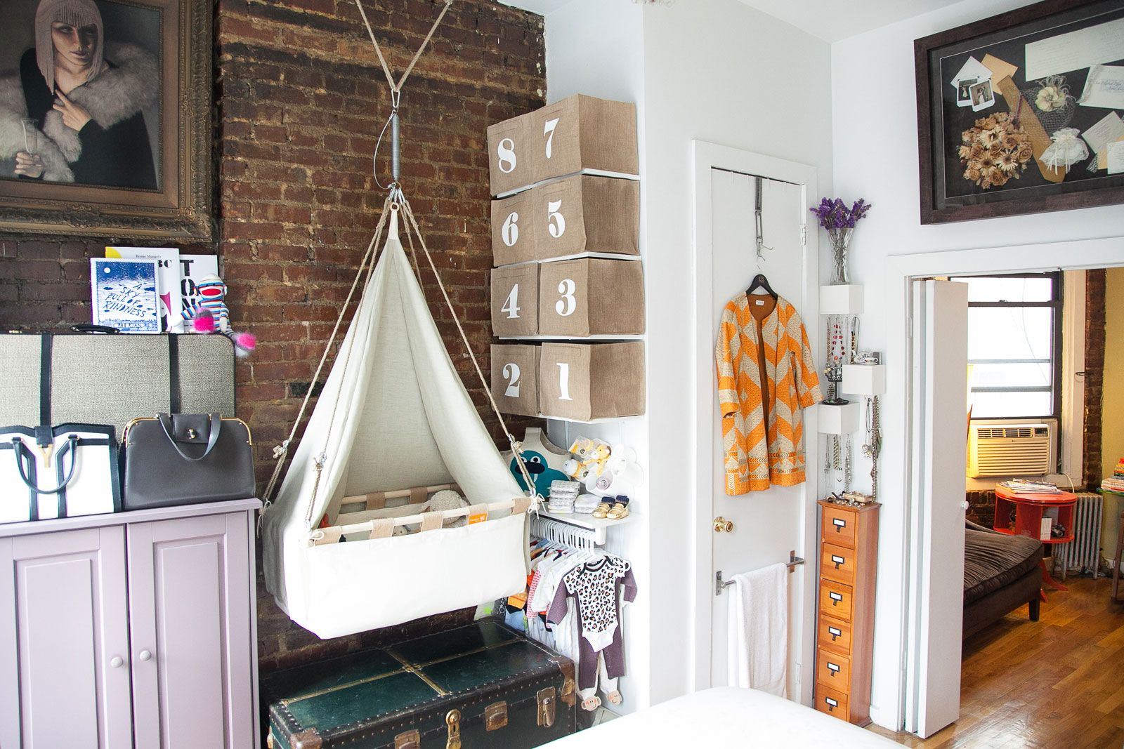 """How A NYC Couple Fit A Nursery Into A 400-Square-Foot Loft #refinery29  http://www.refinery29.com/baby-room#slide-5  Where did you find the hanging bassinet? How did you secure it to the ceiling? """"After much research and brainstorming, I knew there had to be a better way to save space and integrate this child into our life. To me, it just made sense to create something that was more of a built-in baby space. I found the Dutch company Kindekeklein and knew this had to be part of my design…"""