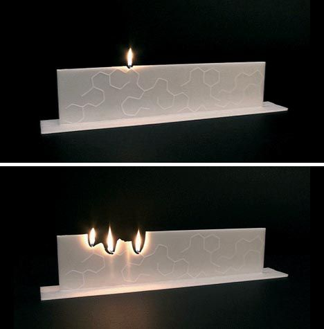 Creative Candles - Christop Van Bommel: A single flame lights additional ones. so cool!