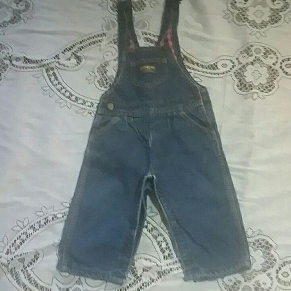 Vintage Oshkosh bgosh overalls Vintage Oshkosh bgosh overalls for little girl size 9-12 months. From the 80s. Inside is pink plaid snaps on inner legs..need to be washed was stored away Oshkosh  Jeans Overalls