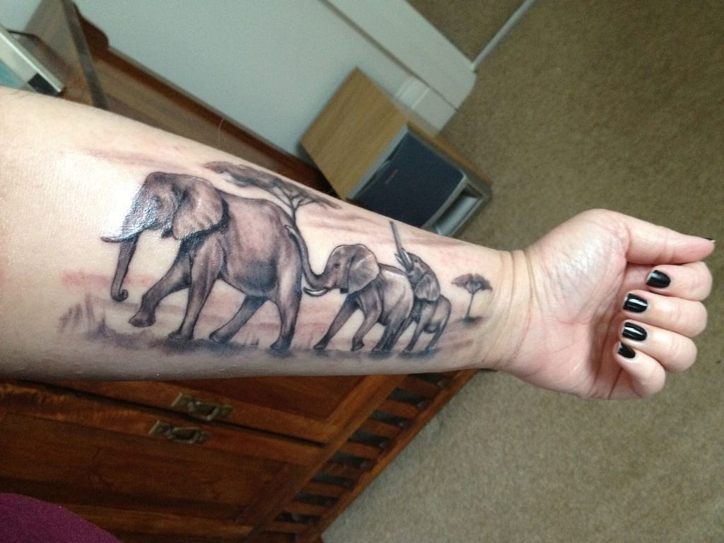 Elephant family tattoo general pinterest elephant for Elephant tattoo meaning family