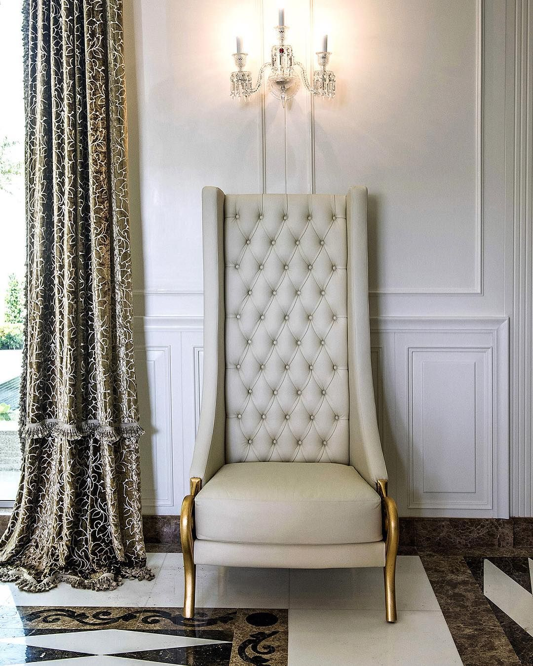 A Luxury High Back Chair Finished In A White Leather And Gold