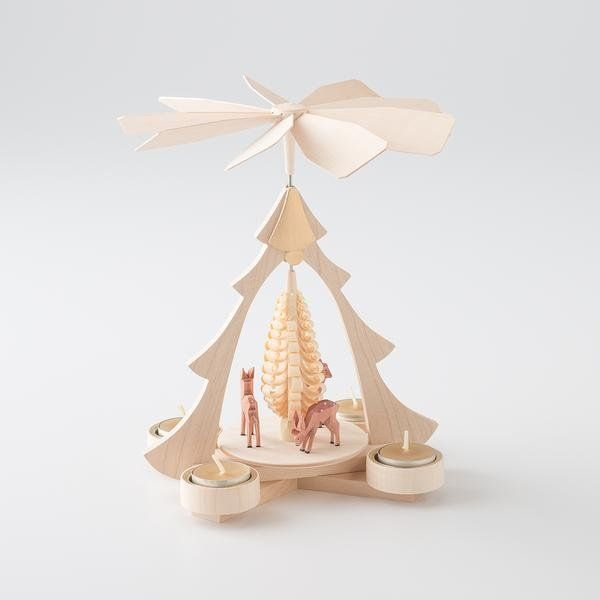 An heirloom-worthy artifact of traditional German folk art, this handcrafted wooden carousel is the ultimate festive centerpiece for your home. Light the tealig