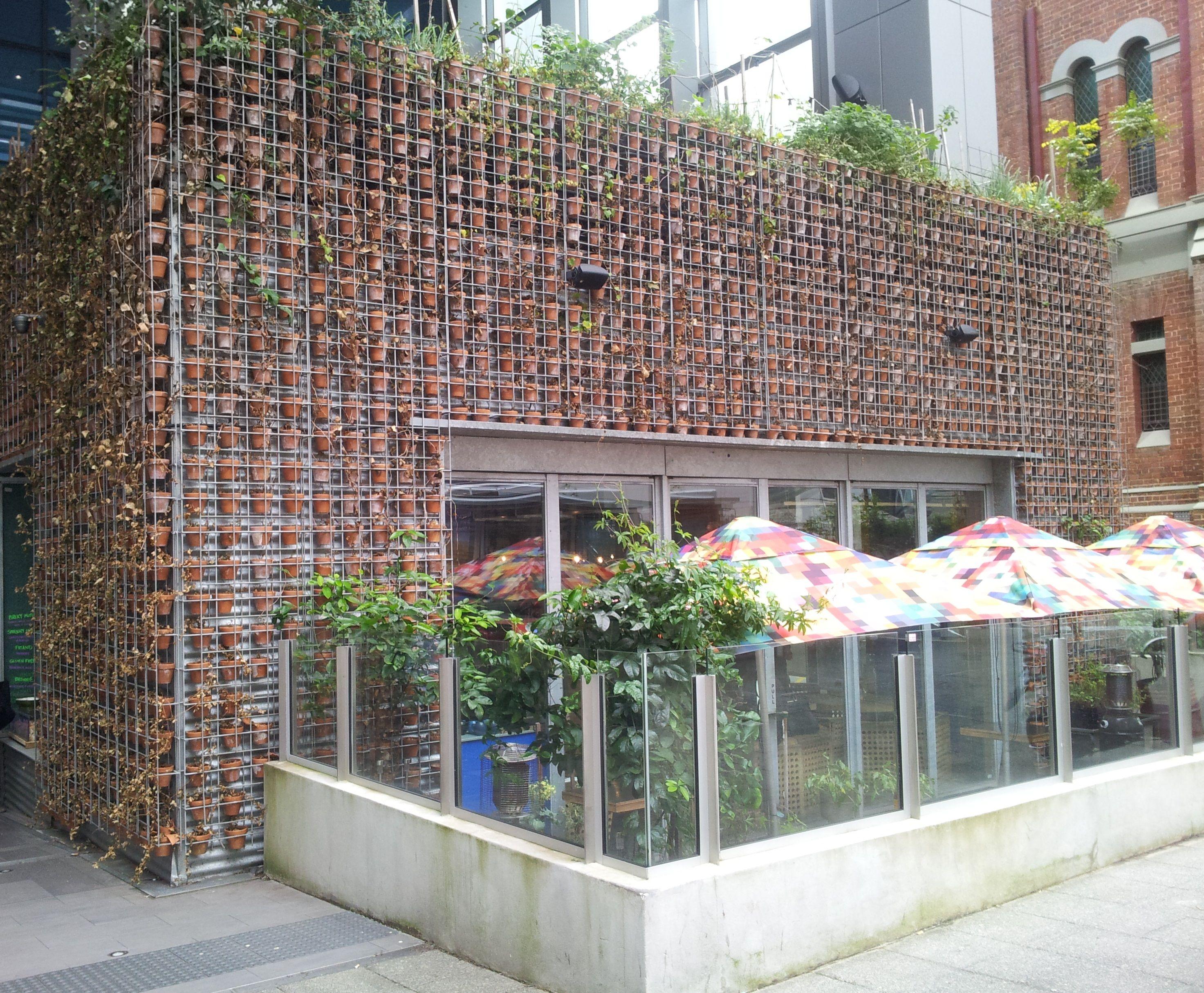 walls of terra cotta pots | >> Outside