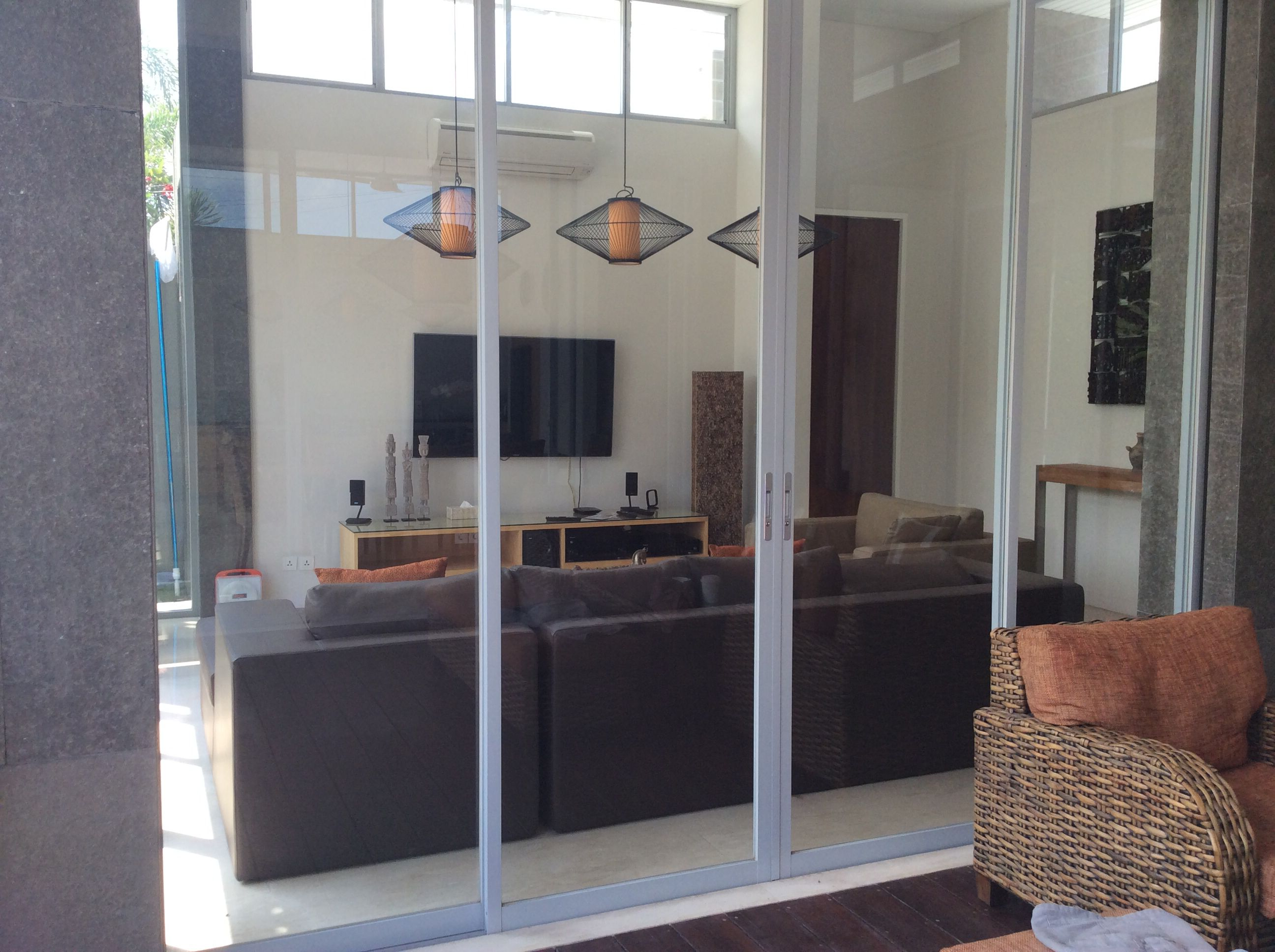 Lounge Room With Tall Glass Sliding Doors Villa Aramanis C