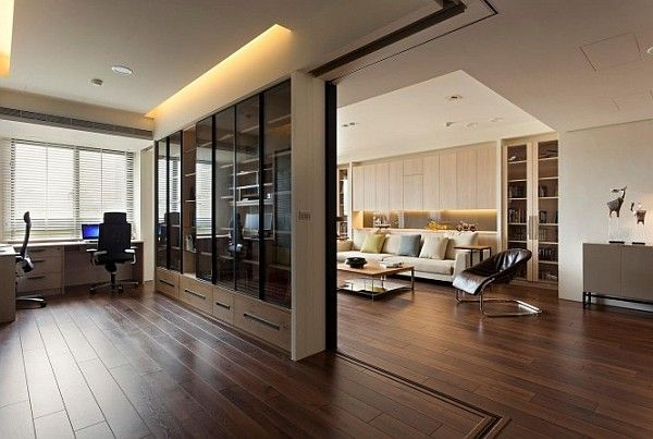 Modern apartment with retractable glass walls for home office area ...
