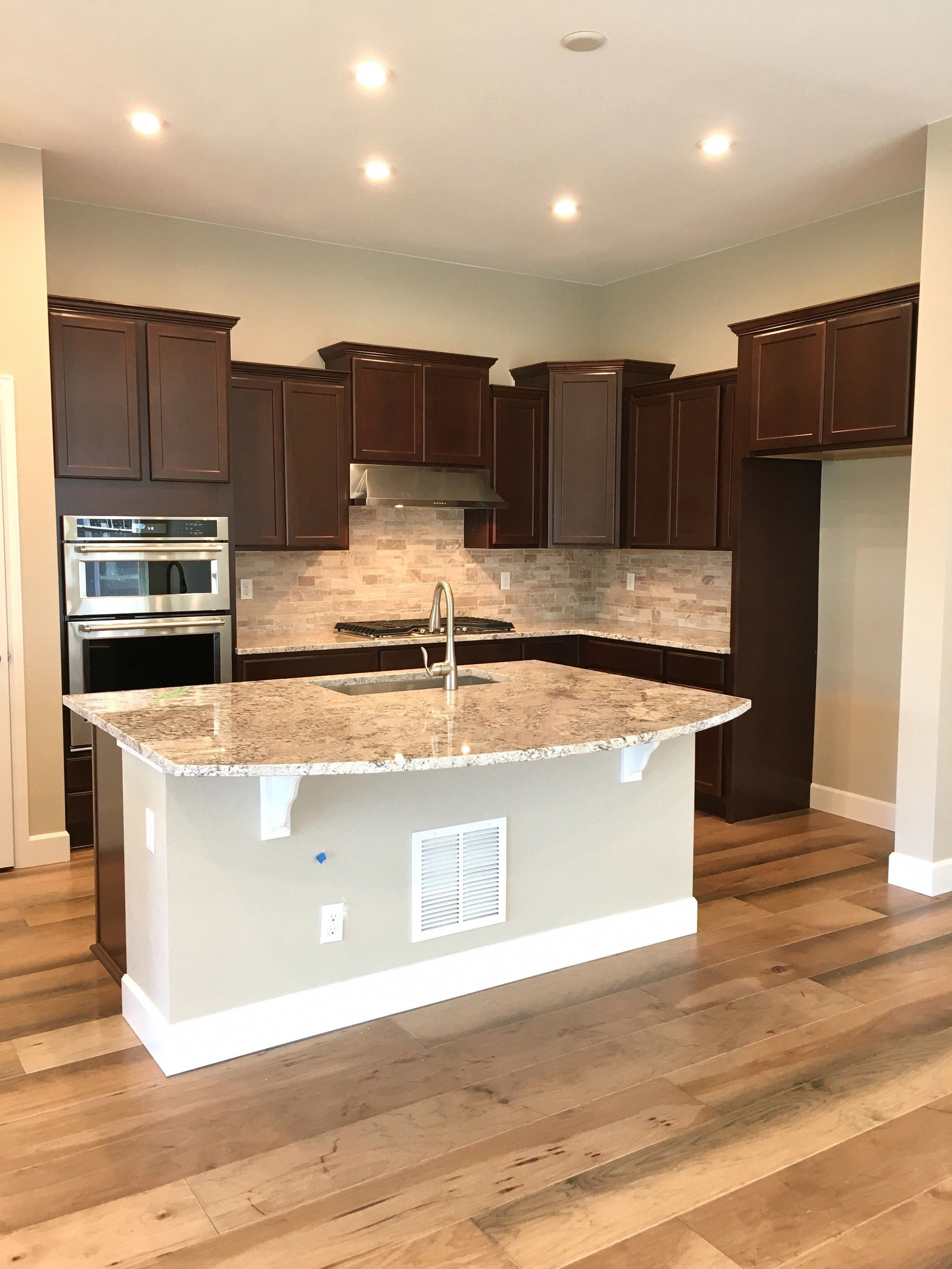 Cherry kitchen cabinets with 9