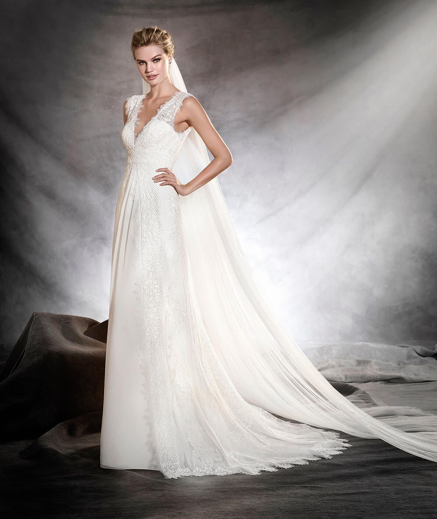 Odilia is a beautiful empireline wedding dress with a flared skirt