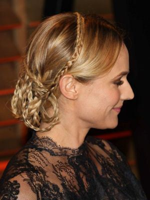 The braided bun Diane Kruger. Always chic and elegant, the muse of Chanel offers a romantic look to perfection with a bun braided to the collar with a black lace dress. Diane Kruger at the Vanity Fair Oscar Party © FS2 / WENN.COM / SIPA