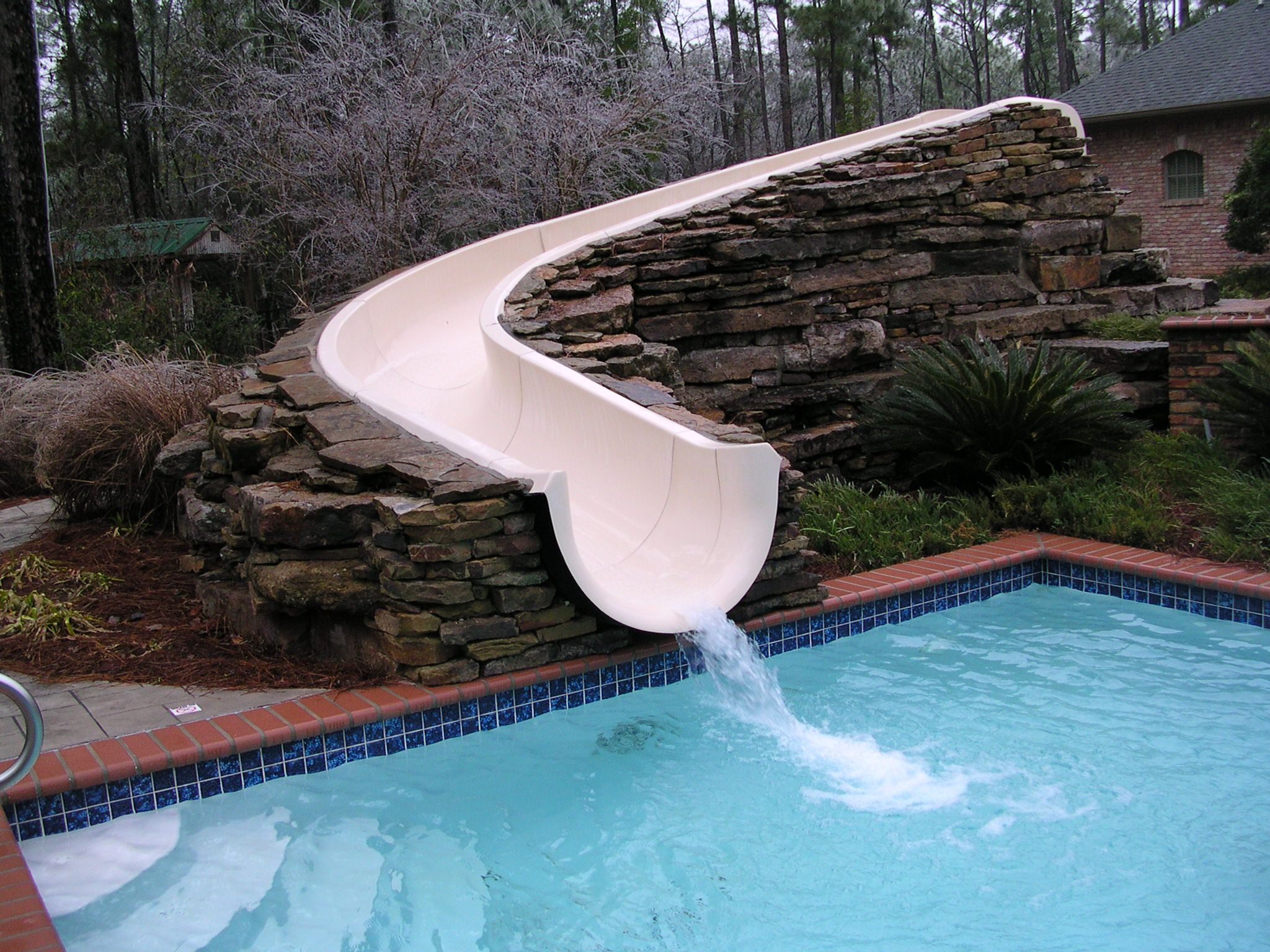 Stacked Stone Swimming Pool Slide