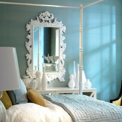The Lily Mirror on a blue wall adds drama and flair @coachbarn.com