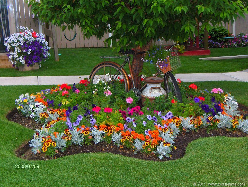 Joli parterre d coration jardin fleurie pinterest for Decoration parterre exterieur