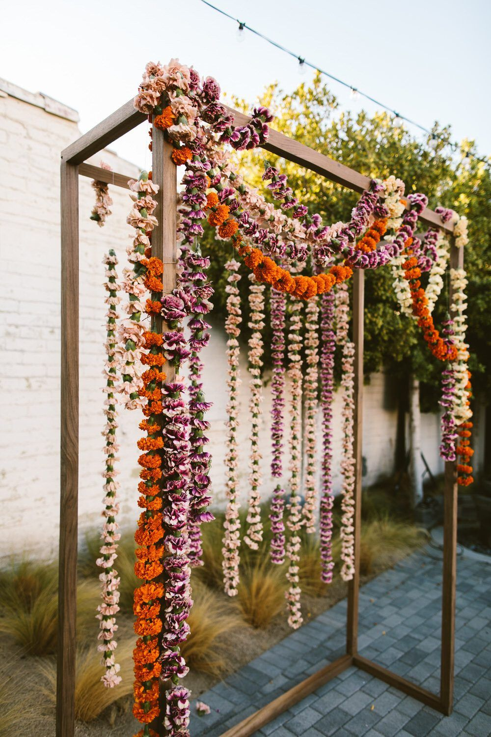 Bursting with blush, amber and orange marigolds, this Palm Springs wedding is all about the saturated summer hues and fruity accents. Southern California wedding vendors have truly outdone themselves with this one!