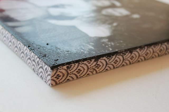 Acrylic on the corners, scrapbook paper of the edge, matte mod podge, picture the size of canvas. Gorgeous!