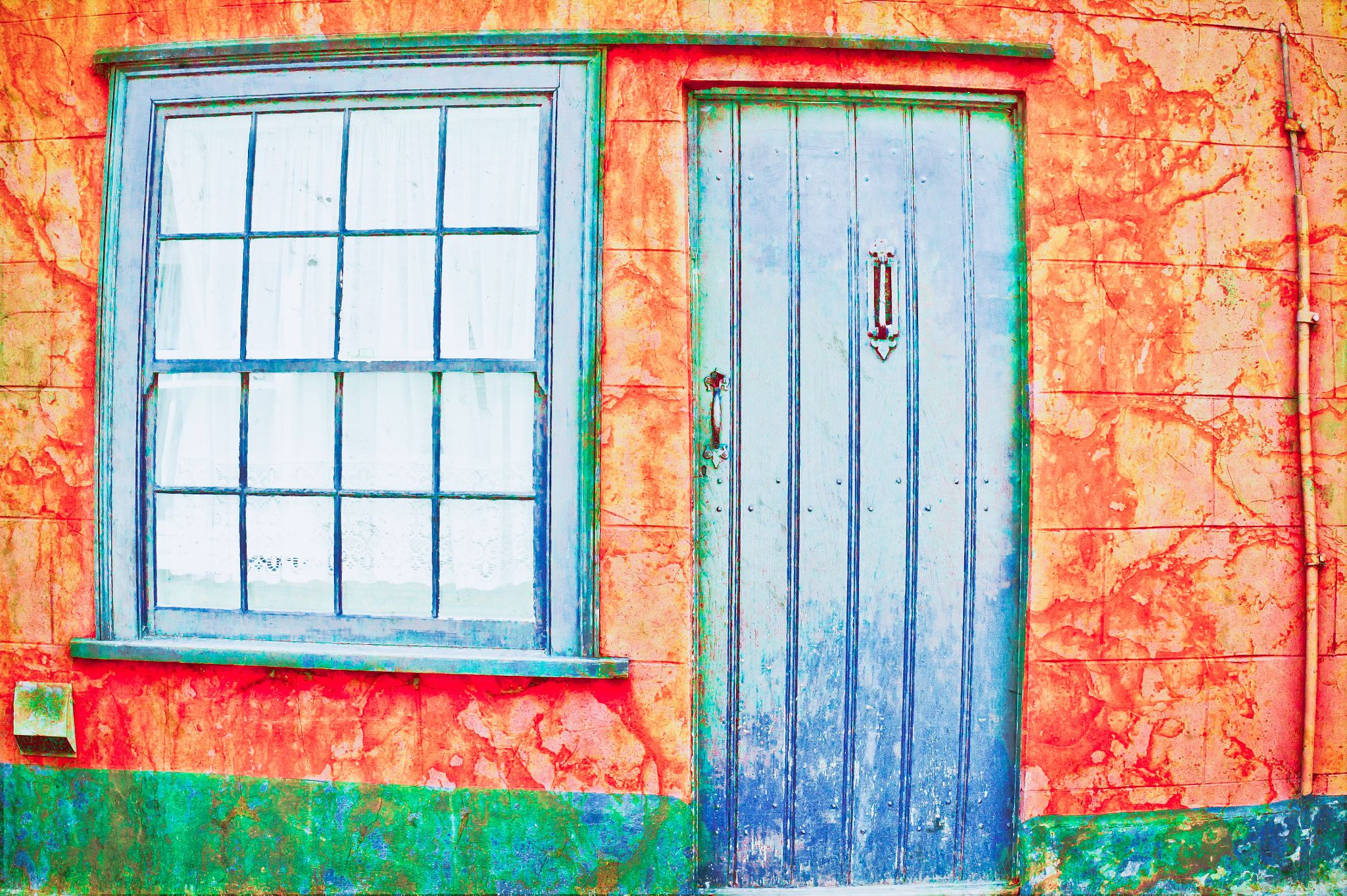 English cottage - A bright orange english cottage with a blue door and window