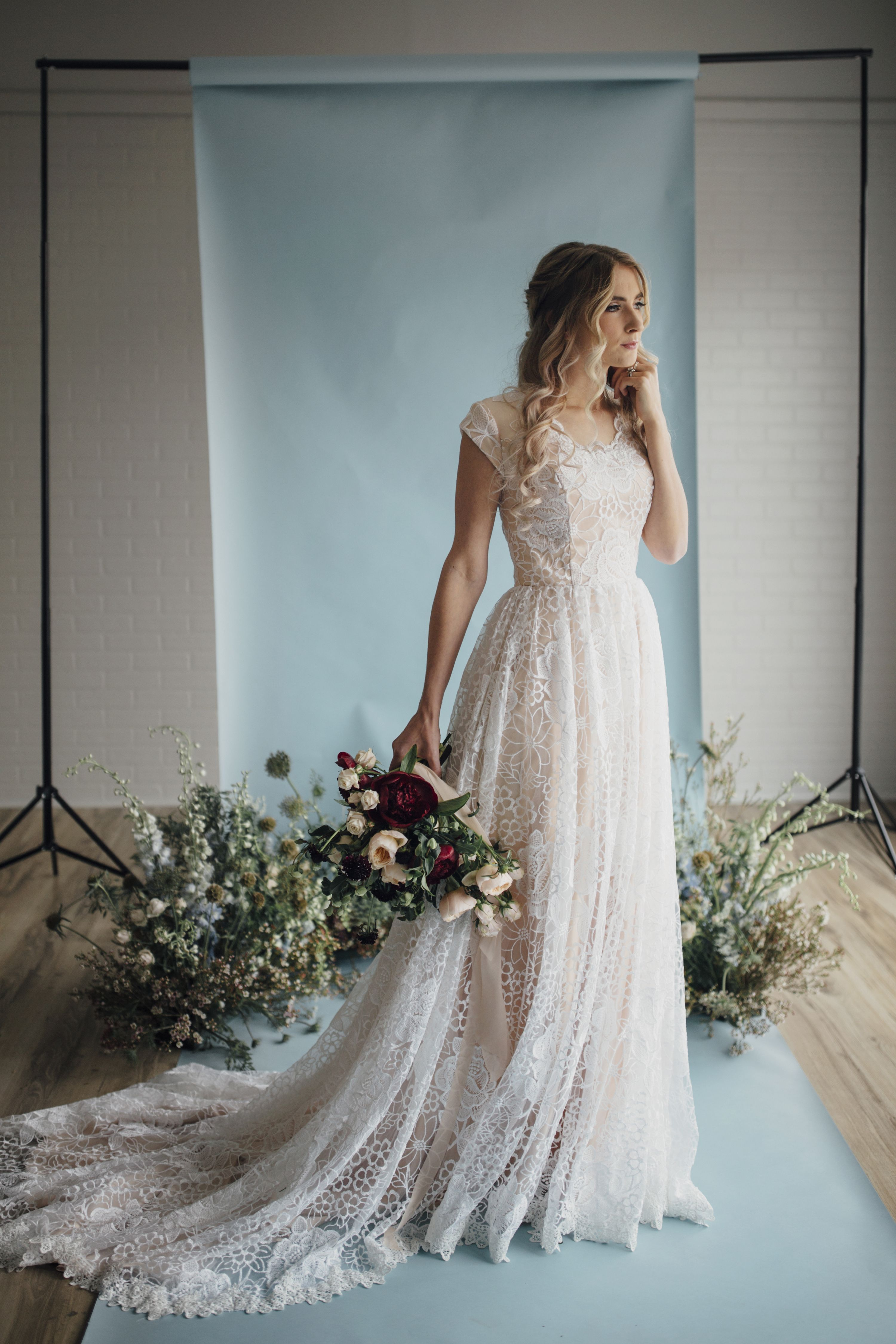 Blush wedding dress with sleeves  Hazel gown by Elizabeth Cooper Design  Photo by Cassandra Farley