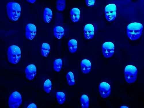 For a creepy effect, paint cheap dollar stores masks with glow in dark paint and hang on walls, either in groups or just one or two.