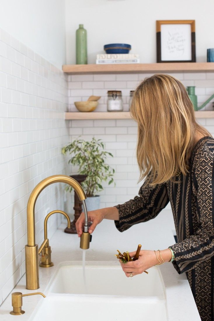brass faucet kitchen menards kitchens an la cliffhanger go high or stay low gold is back fixtures and in murnane house los angeles by project m plus remodelista