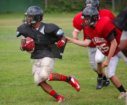 HIGH SCHOOL FOOTBALL: New coach, new hopes for North Quincy football. Running back Antoine Allen stays a step ahead of would-be tacklers during a recent North Quincy High football practice. Quincy, MA - The Patriot Ledger