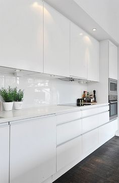 black white contemporary loft in stockholm sweden white gloss kitchenwhite cabinet
