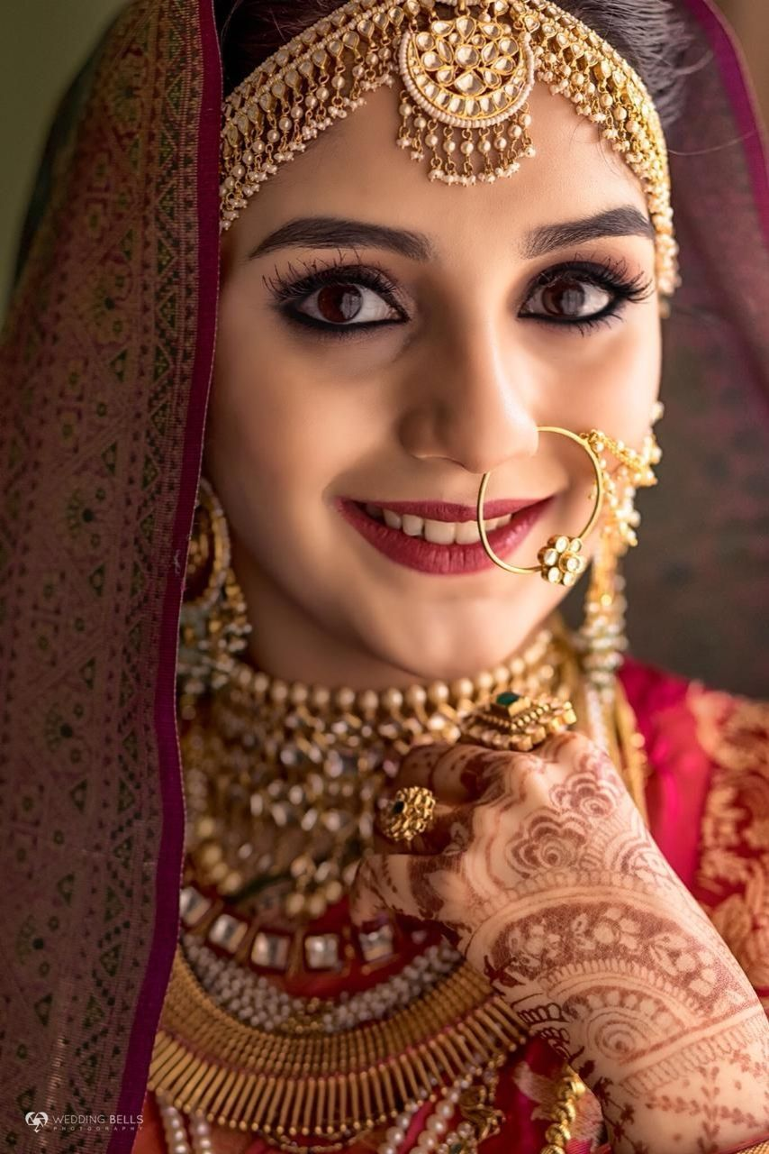 Traditional Indian Bride In Red And Gold