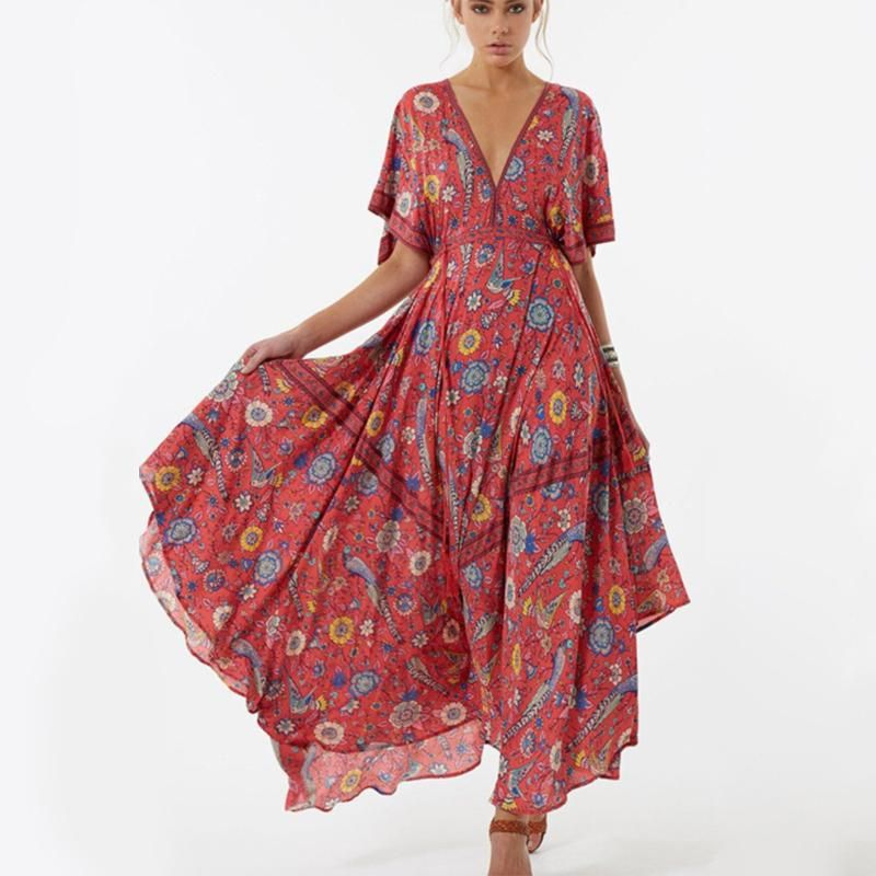 3c23af74b2 Dress in classic bohemian style with this beautiful v-neck maxi dress that  features a unique floral print that adds that touch of retro charm.
