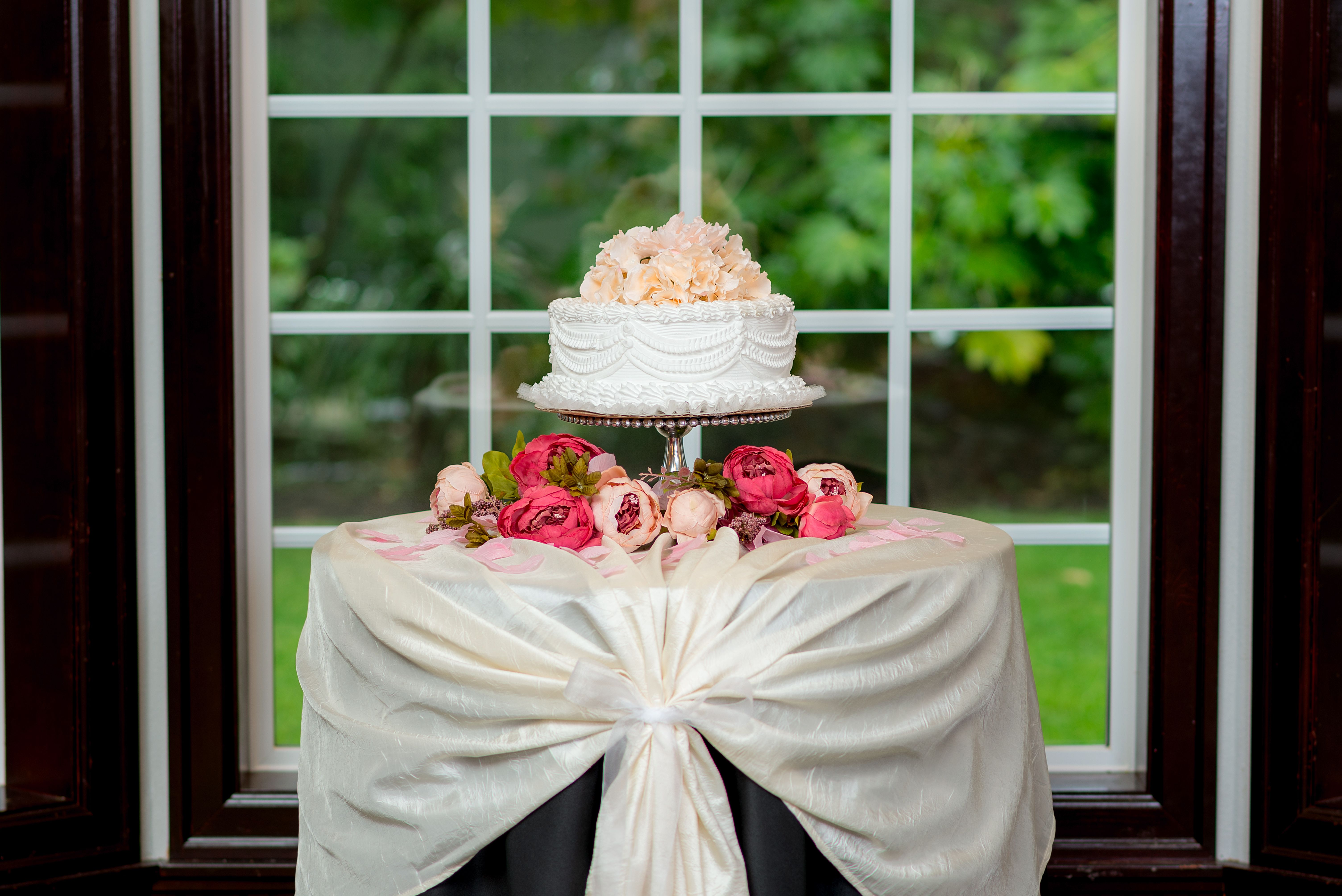 Layered tablecloths dress up the cake table delightful wedding