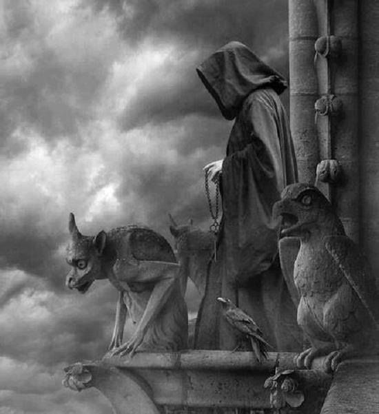"""Gargoyles appeared during the Romanesque era, but were extremely popular during the Gothic period.  Some are made to be """"down spouts"""" for rainfall, while others appear to be guarding the structure/entrance.  We cannot say whether it was to scare people away or the protect them.  I think this one has a rather ominous feel to it!  Maybe that's partly because the image is in black and white."""