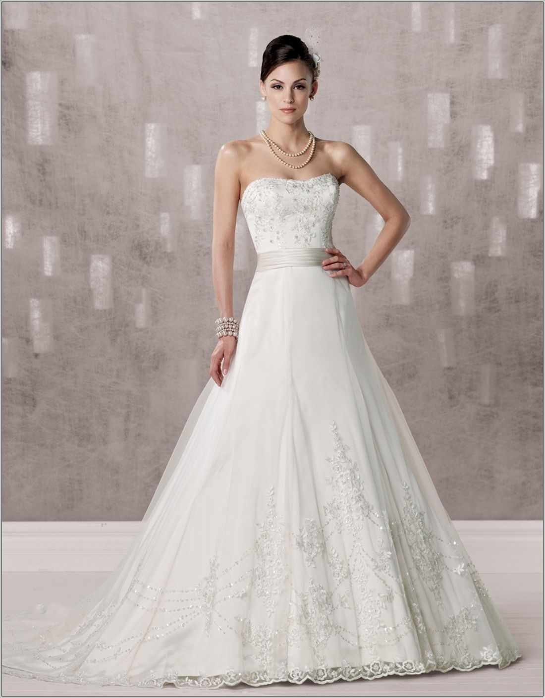 This one is a strapless trumpet gown which is made by tulle netting