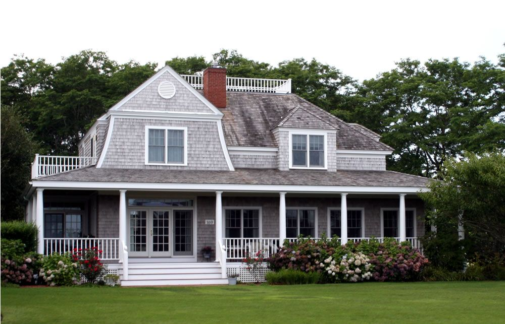this cape cod style home has had additions for more space