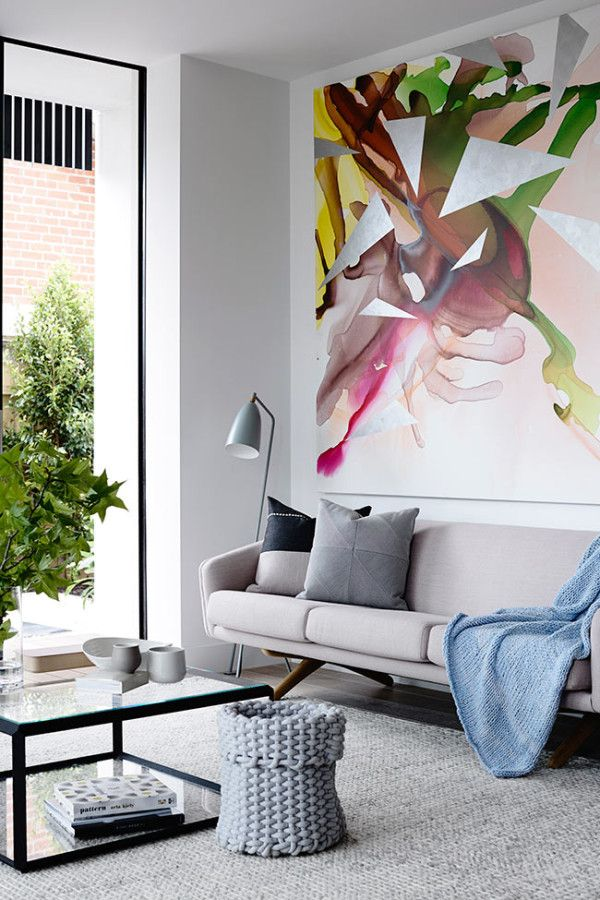 Living Room Art Decor Christmas Decorations For A 10 Rooms With Oversized Interior Design Designs The Crisp Street Apartment Was Designed By Mim And S Neutral Modern Is Topped Off Beautiful Abstract Painting In Both
