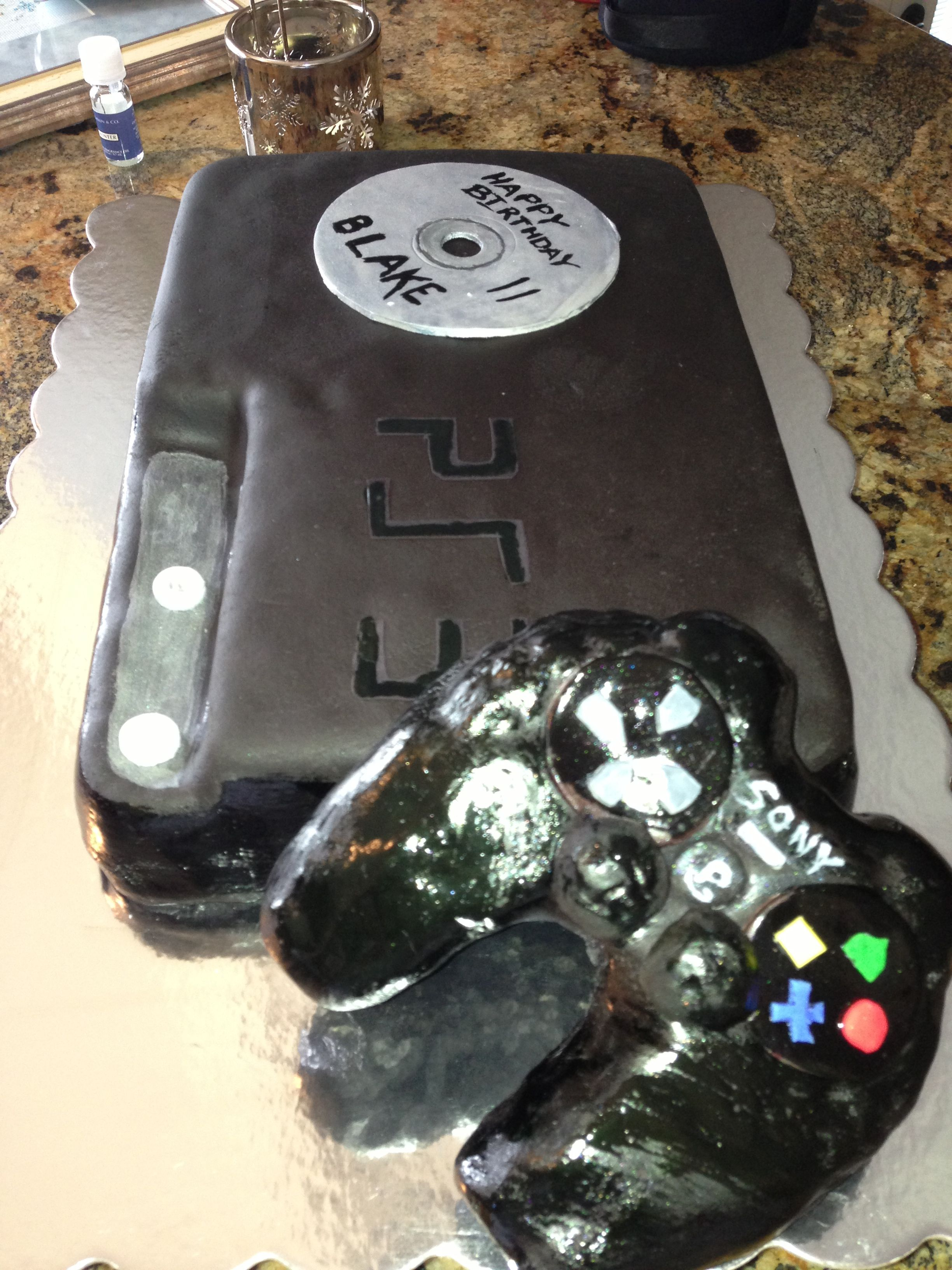 Blakes PS3 Birthday Cake.  Wiltons rolled fondant recipe.  Made the controler out of rice crispy treat.  And the CD is just Fondant.  PS3 was cut out of sugar sheets.  Fun to make