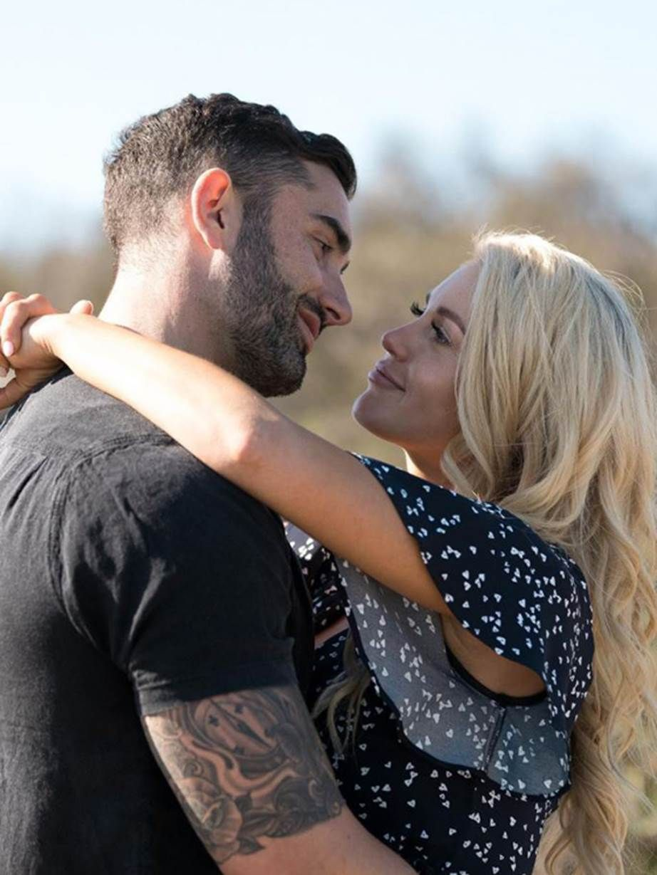 From the moment he stepped out of the limo at the Bachelorette mansion, Ali Oetjen was attracted to contestant Taite Radley. See the couple's road to love in pictures.