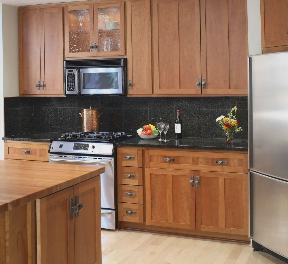 Backsplash Ideas For Black Granite Countertops And Maple ... on Backsplash For Maple Cabinets  id=37788