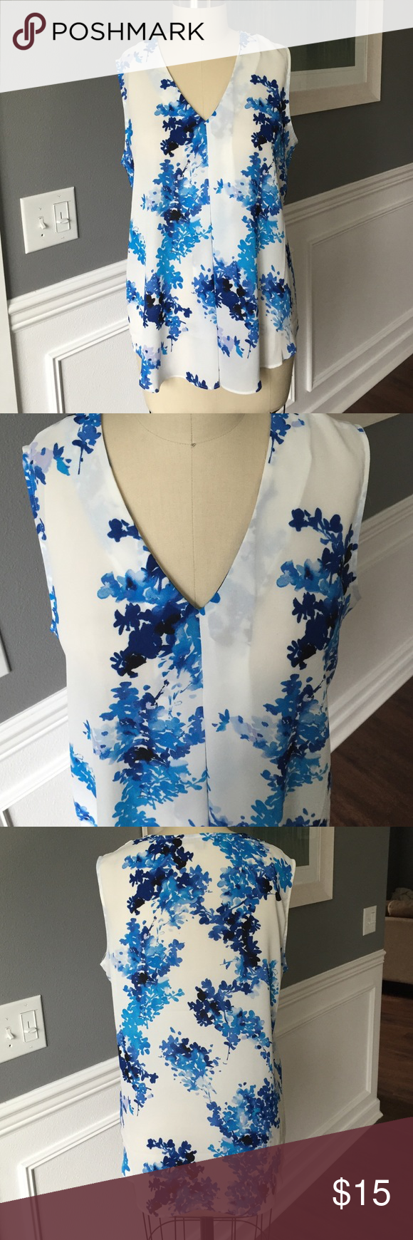 Rose & Olive Floral Sleeveless blouse Polyester sleeveless blouse. Pleated down the front. Beautiful floral blue designs. Like new! Rose & Olive Tops Tank Tops