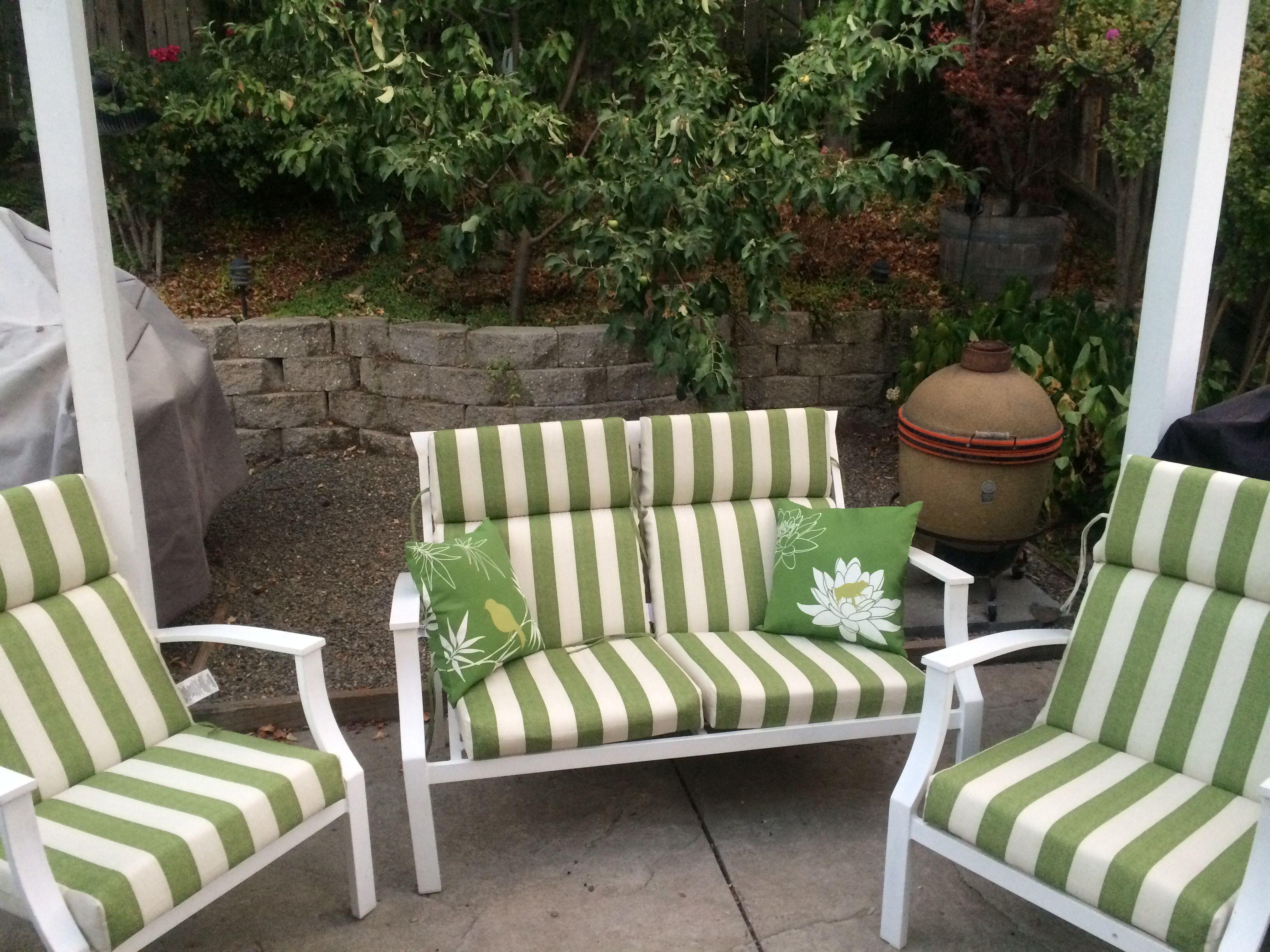 Backyard retreat. Garage sale find furniture with cushions
