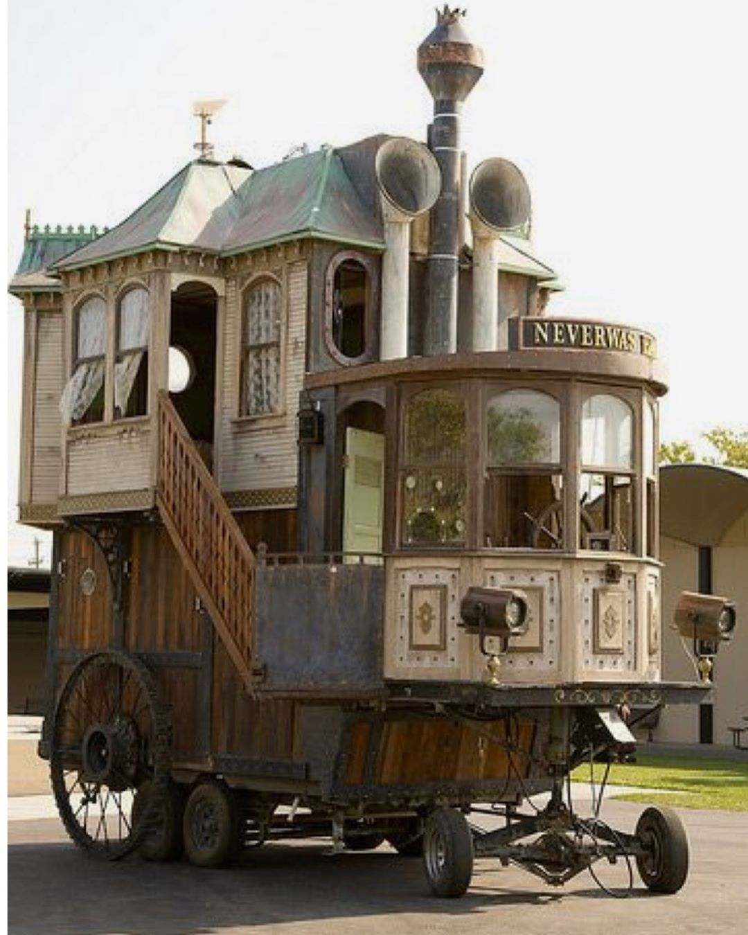 Is this steam punk, victorian gothic, covered wagon camper, with a ship's captain wheel and lace curtains on a derby car chassis too much…